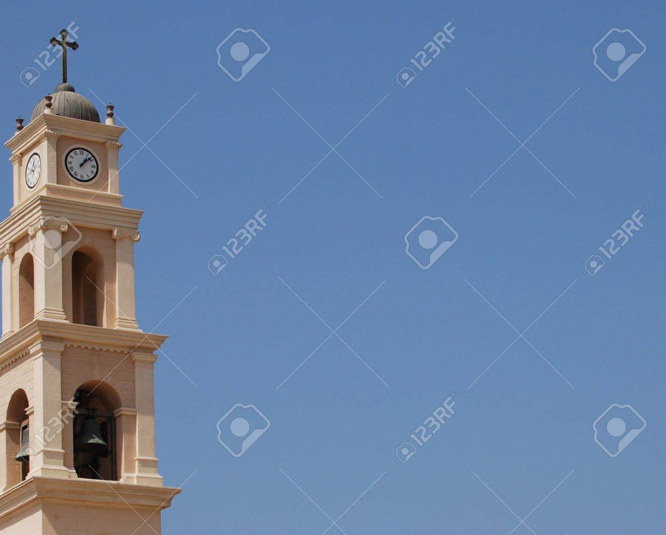 Old tower with clock and cross and bell in israel Stock Photo - 2977598