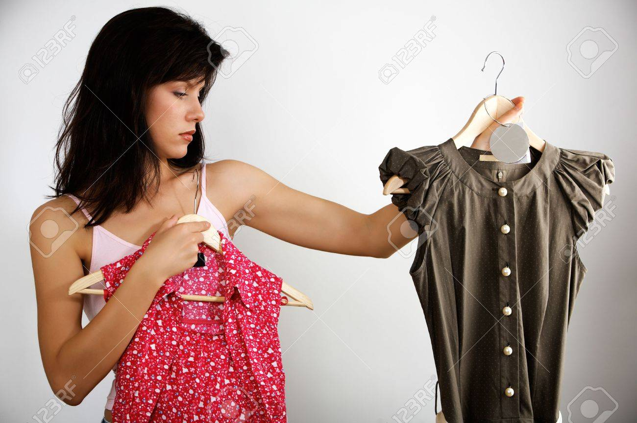 woman is deciding which dress to buy Stock Photo - 3386354