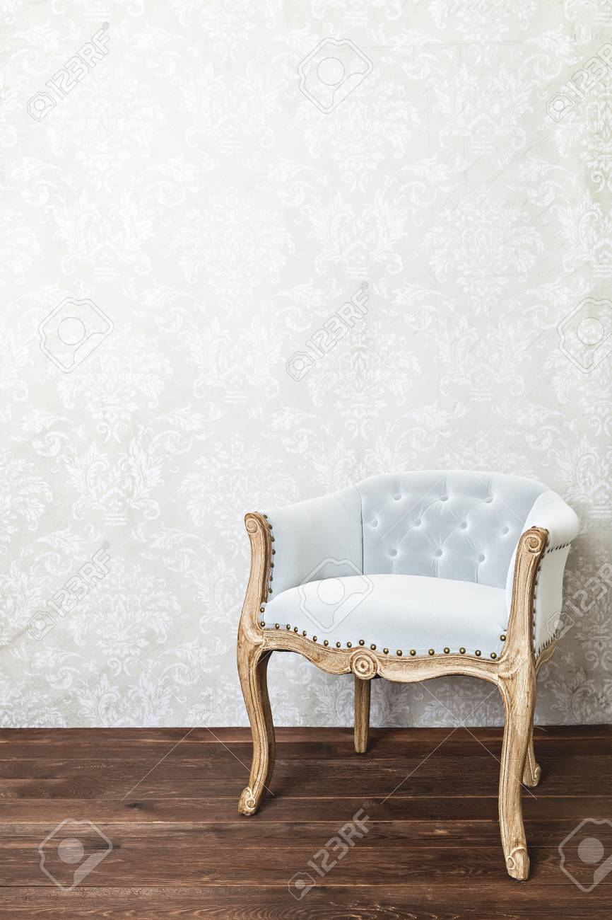 9933353fabf Retro Armchair On Wallpaper Background