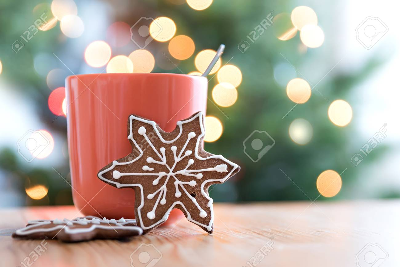 Gingerbread Cookie Standing By Orange Mug Christmas Lights Bokeh Stock Photo Picture And Royalty Free Image Image 68129246