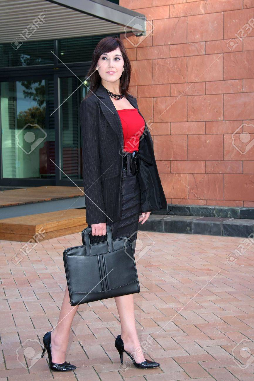 Stunning business woman walking outside office building Stock Photo - 3754276