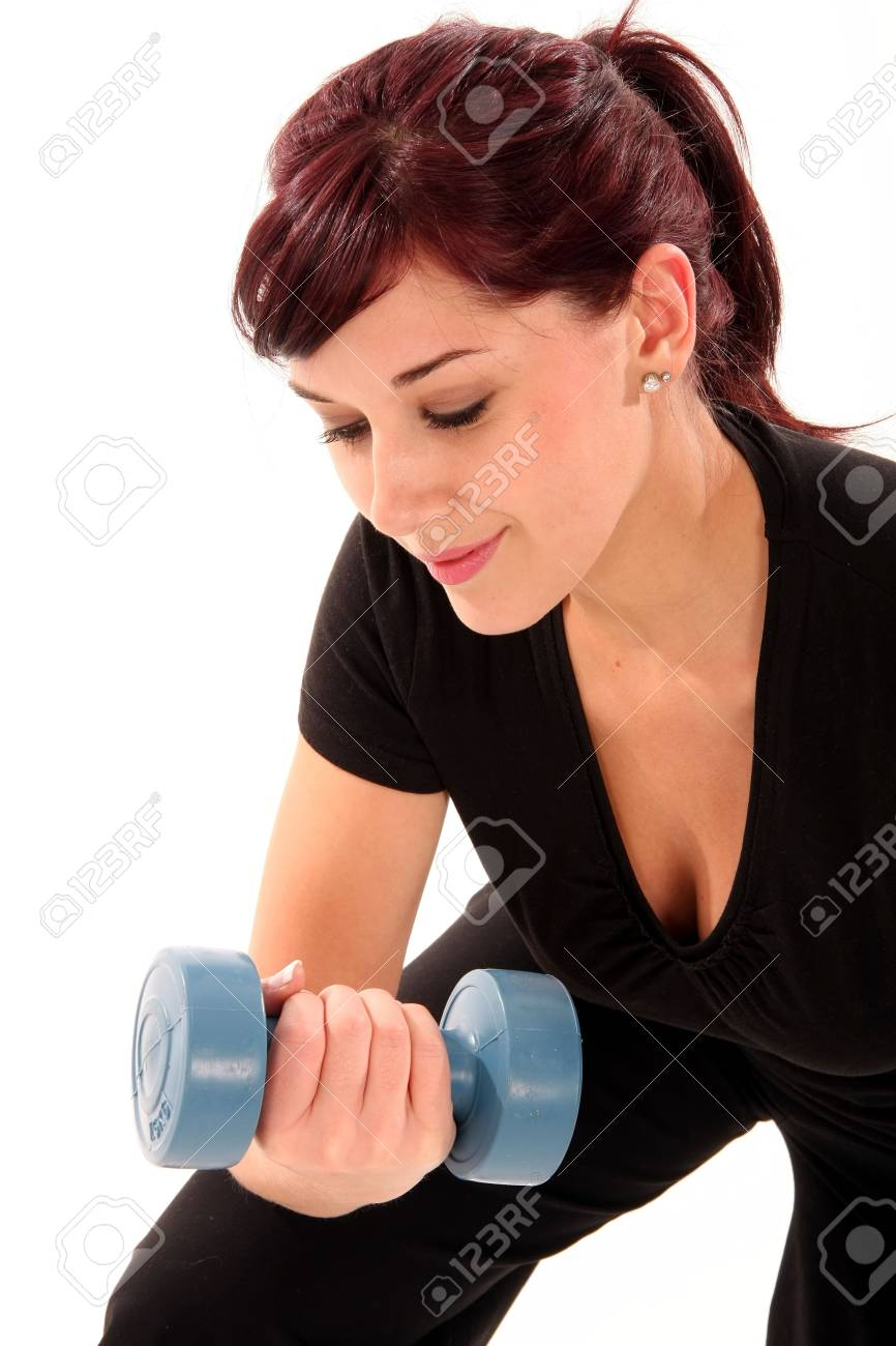 Pretty brunette girl doing healthy exercise with dumbell weights Stock Photo - 5032207