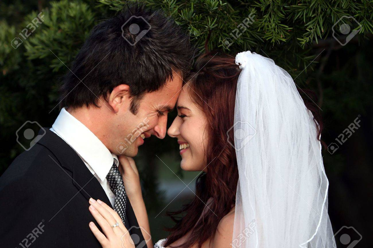 Happy wedding couple sharing an intimate moment Stock Photo - 5976957