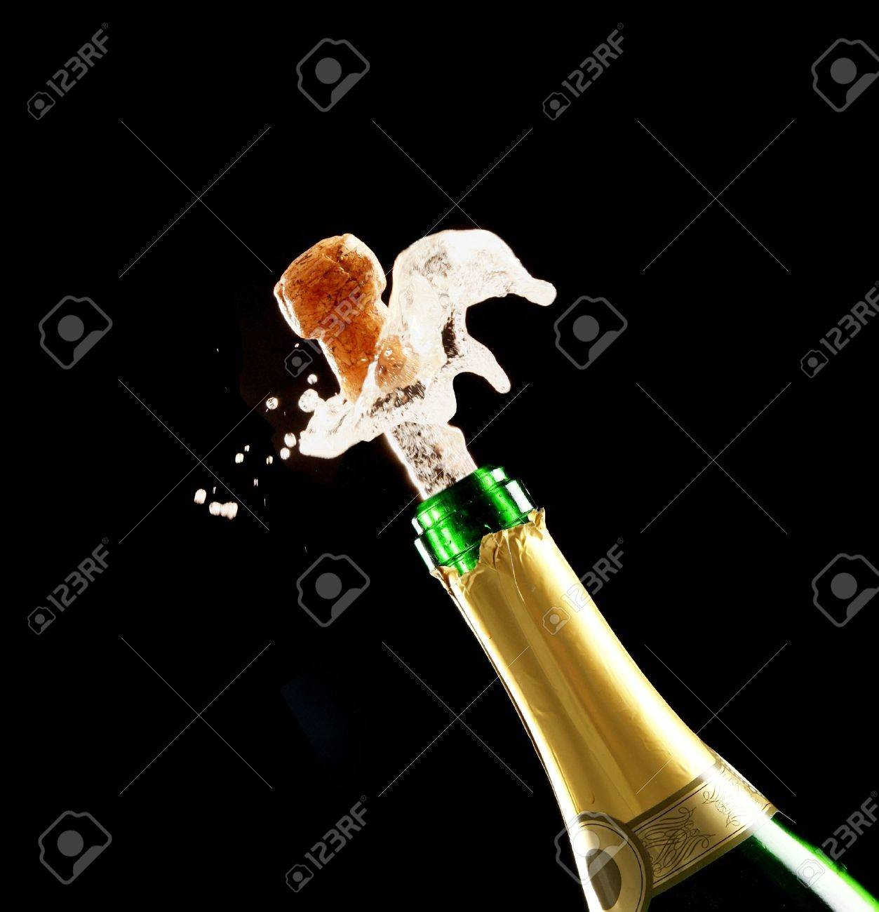 Bottle of champagne just opened with cork being expelled Stock Photo - 8509596