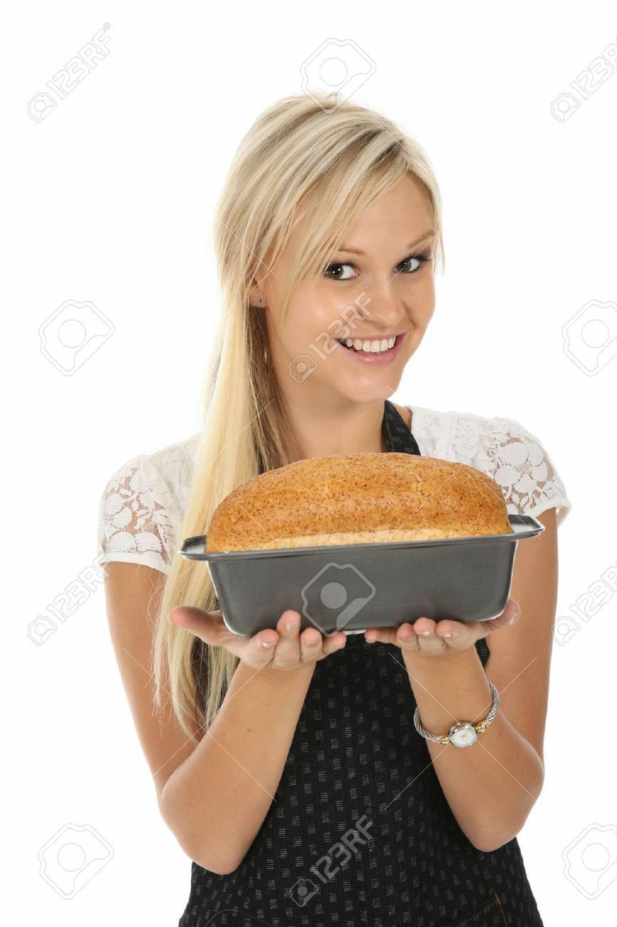 Gorgeous blond woman with home baked loaf of bread Stock Photo - 9493730