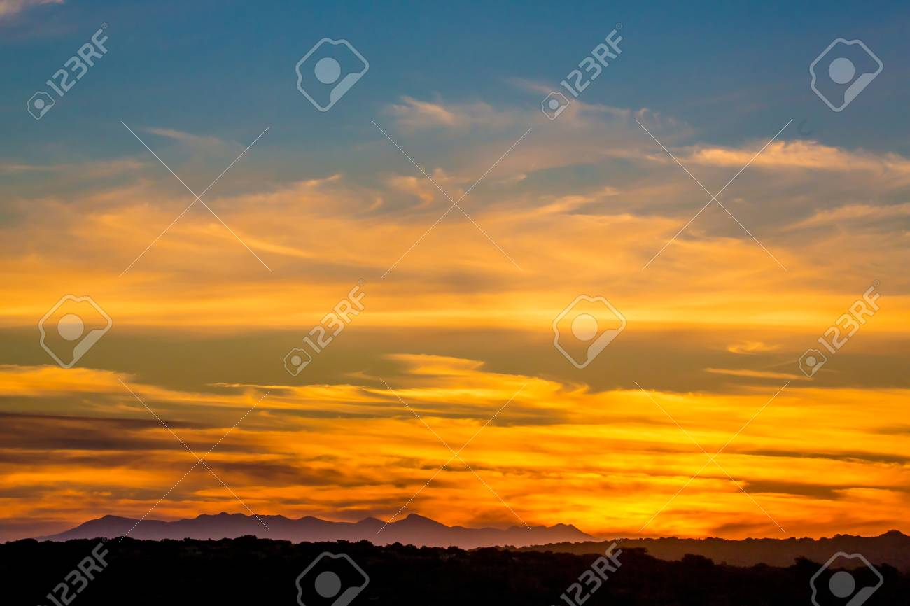 Beautiful Sunset With Orange Sky Over The Mountains In Addo South Africa Stock Photo
