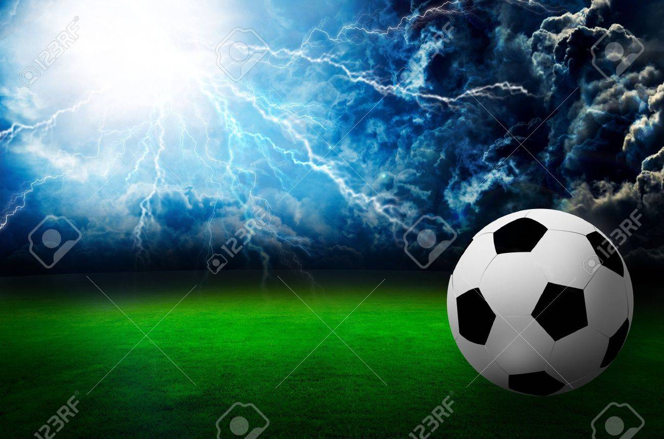football field soccer stadium on the green grass , thunder sky Stock Photo - 14923960
