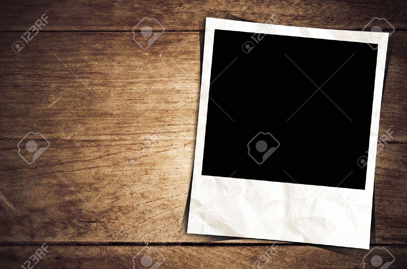 Old photo frame on wood background Stock Photo - 15948672