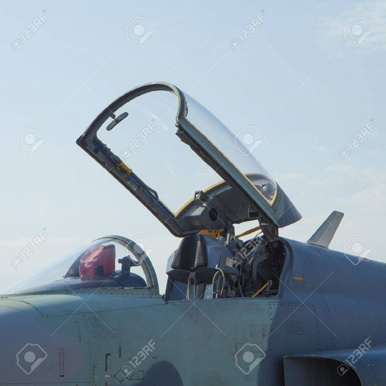 Closeup of military fighter jet cockpit and canopy against a blue sky Stock Photo - 19330153 & Closeup Of Military Fighter Jet Cockpit And Canopy Against A ...