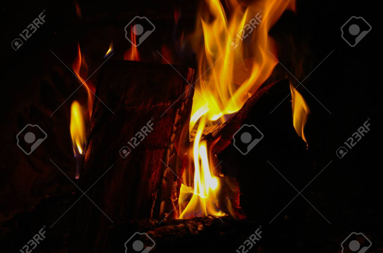 Bright Colorful Flame Burning Wood At The Fireplace Firewood Brick