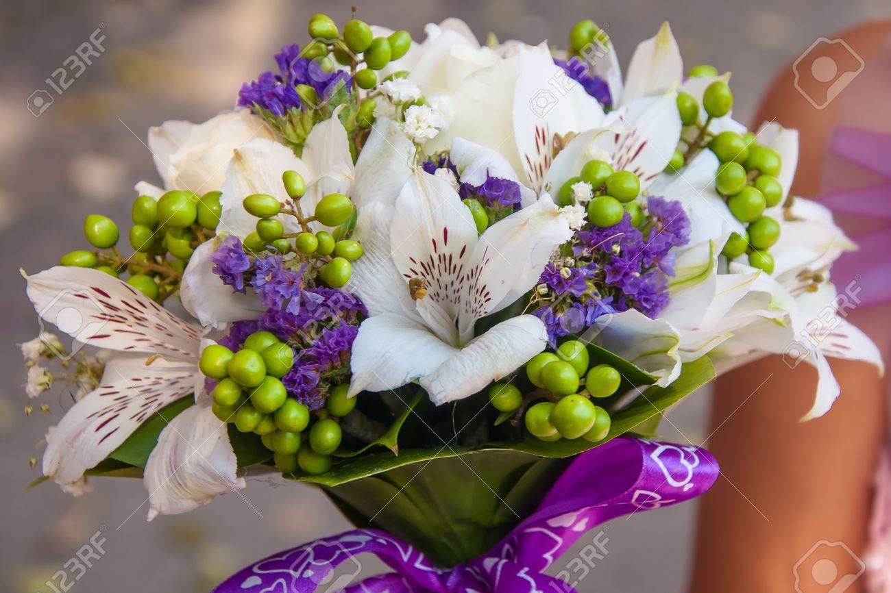 Wedding bouquet of beautiful purple flowers stock photo picture and stock photo wedding bouquet of beautiful purple flowers izmirmasajfo