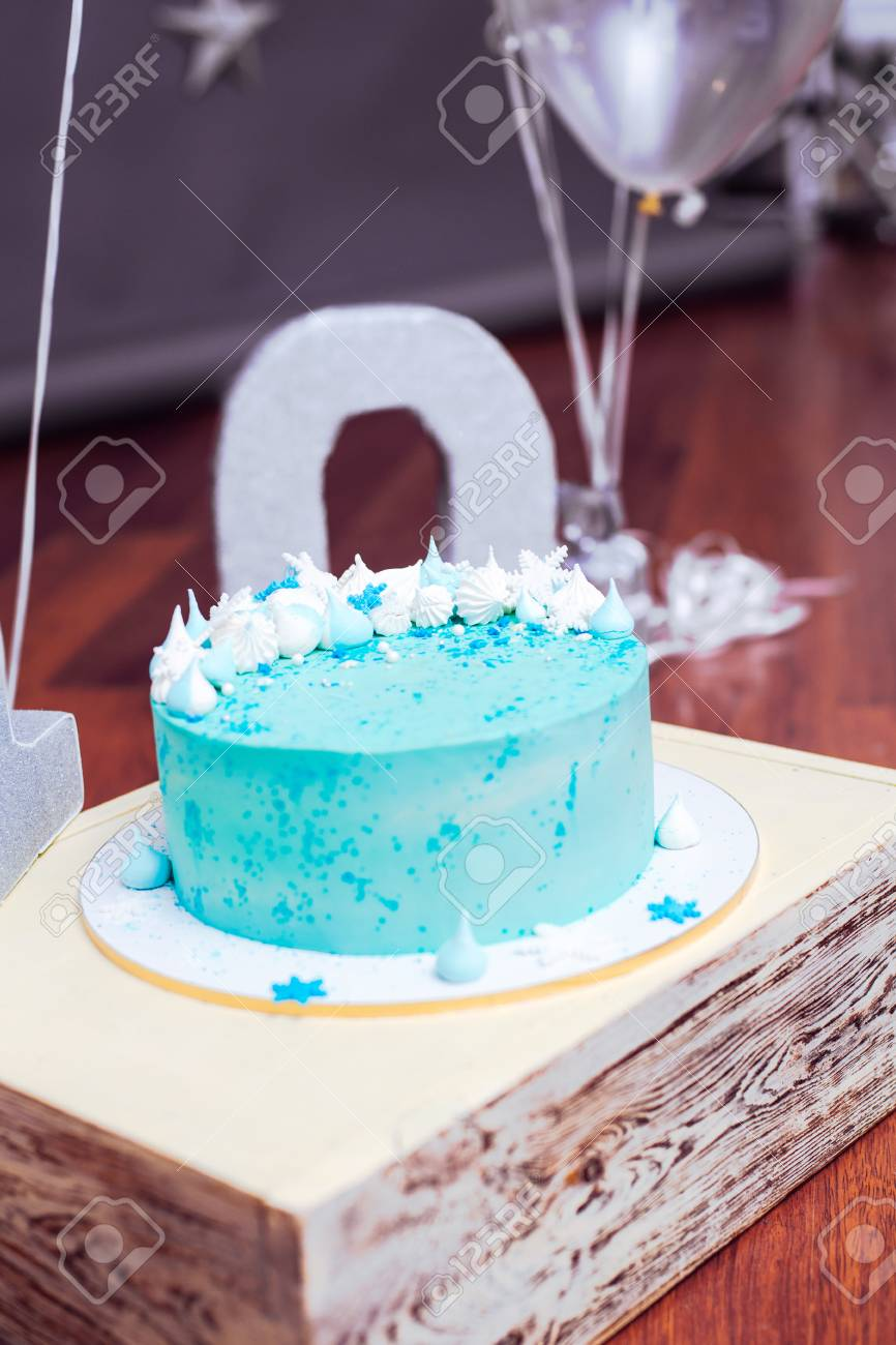 Fine Blue Birthday Cake With Small Meringues And White Snowflakes Stock Funny Birthday Cards Online Elaedamsfinfo