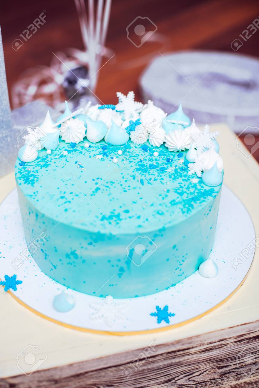 Surprising Blue Birthday Cake With Small Meringues And White Snowflakes Stock Funny Birthday Cards Online Alyptdamsfinfo