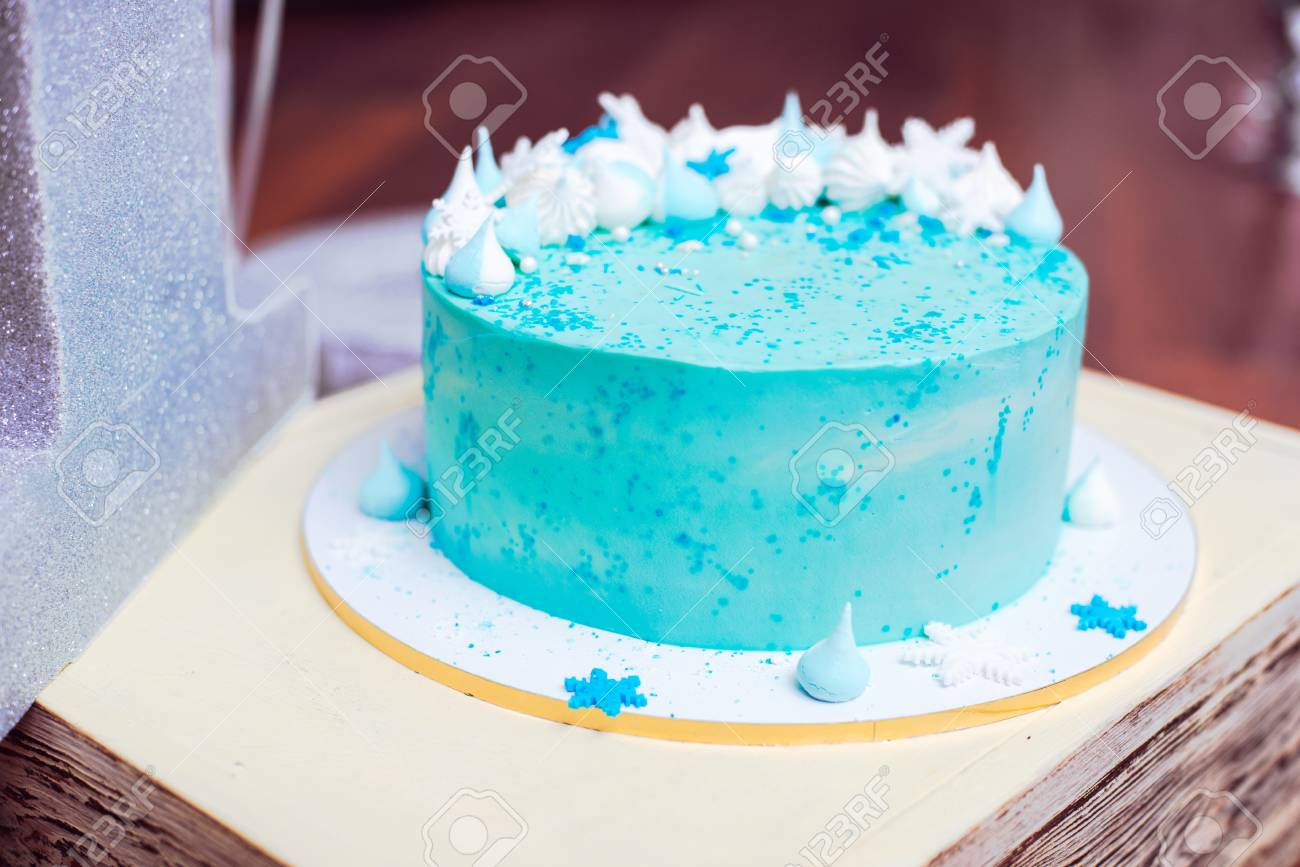 Blue Birthday Cake With Small Meringues And White Snowflakes Stock