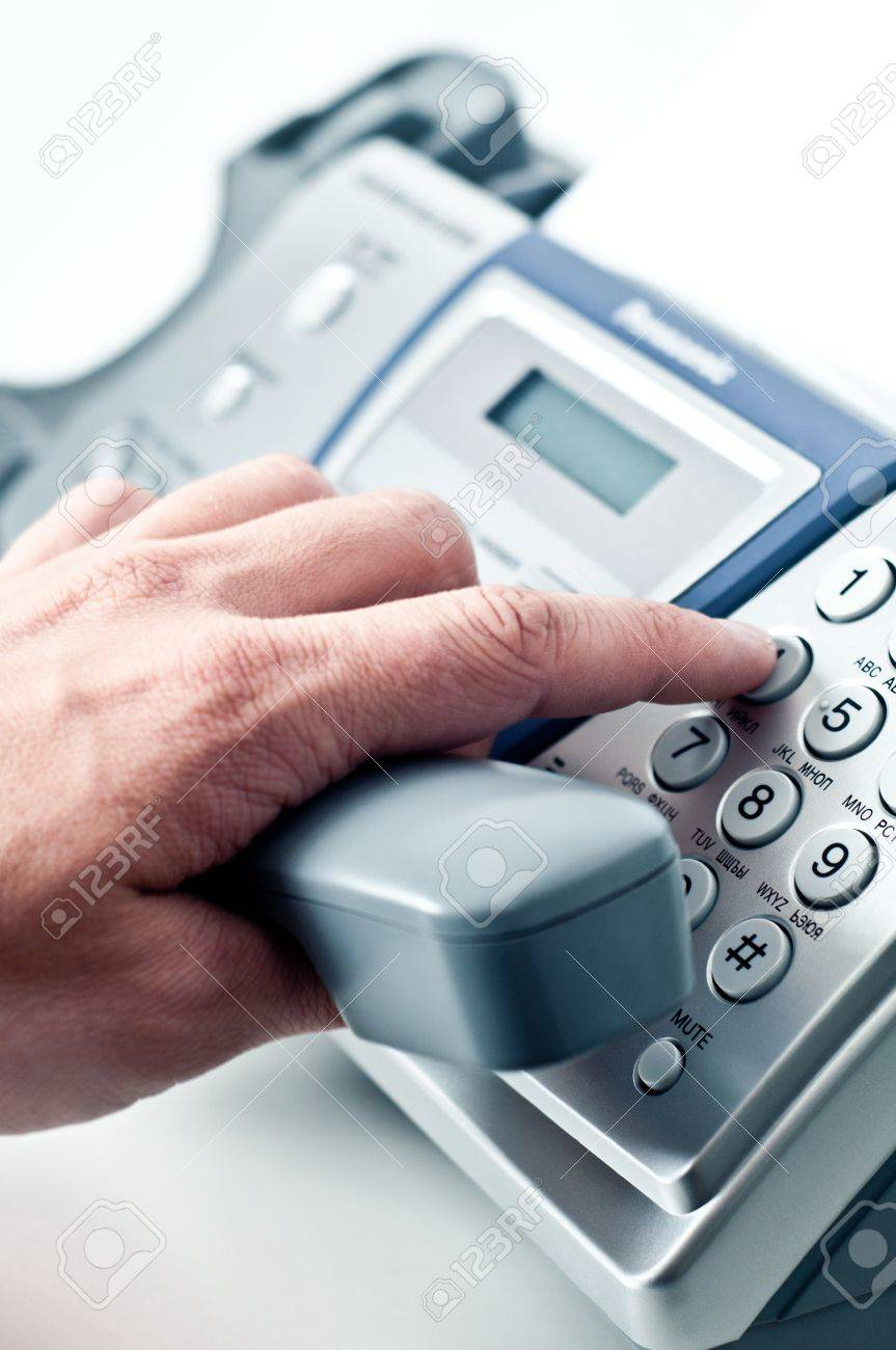 Gray tube of phone-fax in a man's hand. Stock Photo - 9583927