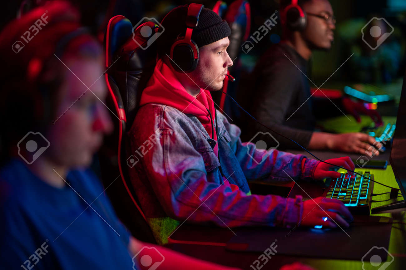 Professional esports players at an online game tournament. The cyber team plays computers and trains - 170401111