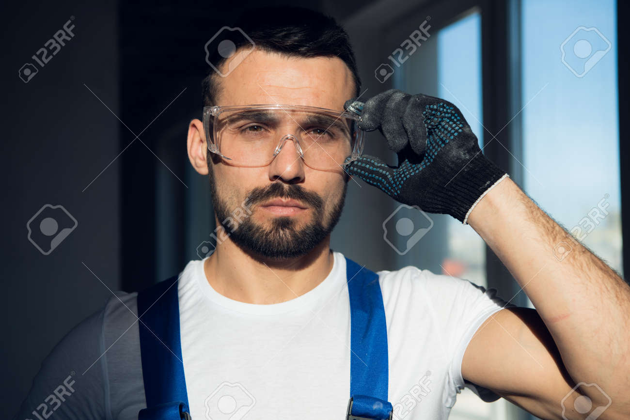 Close up, bearded craftsman wearing protective glasses - 170308388
