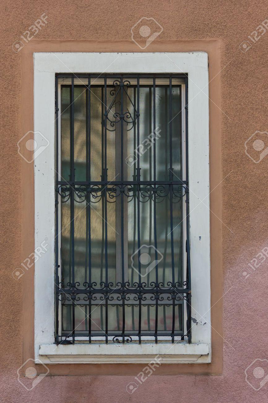 Window grill windows with iron bars stock photo