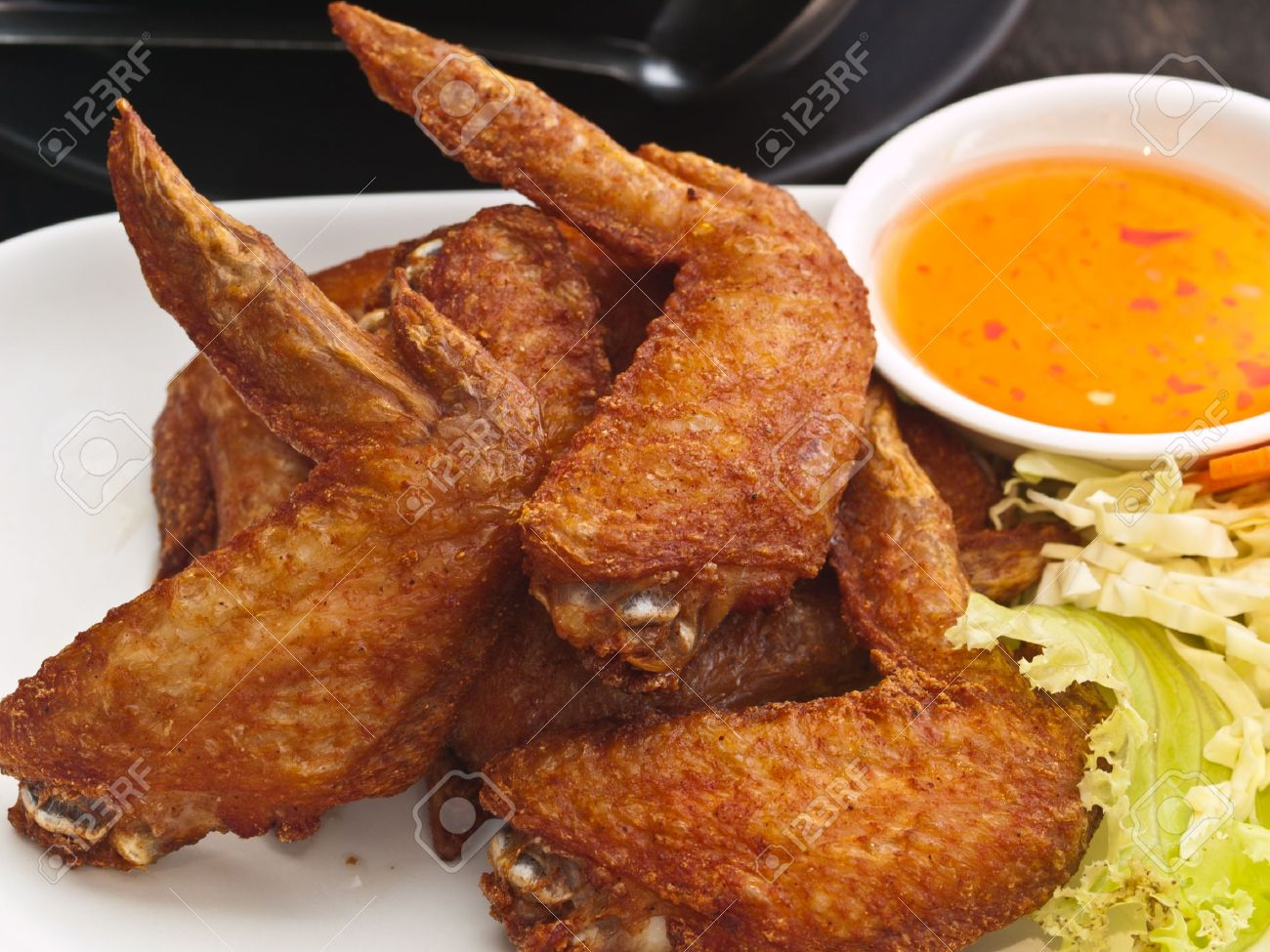 9213591-Fried-Chicken-wing-on-plate-Stoc