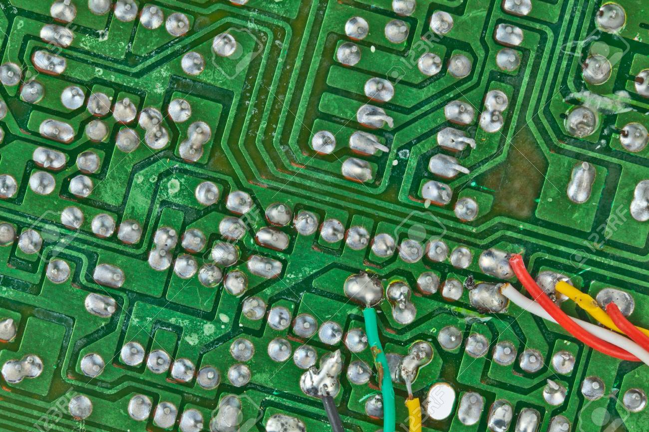 The Printed Circuit Board With Electronic Components Macro Green Computer Electronics And Stock Photo Background