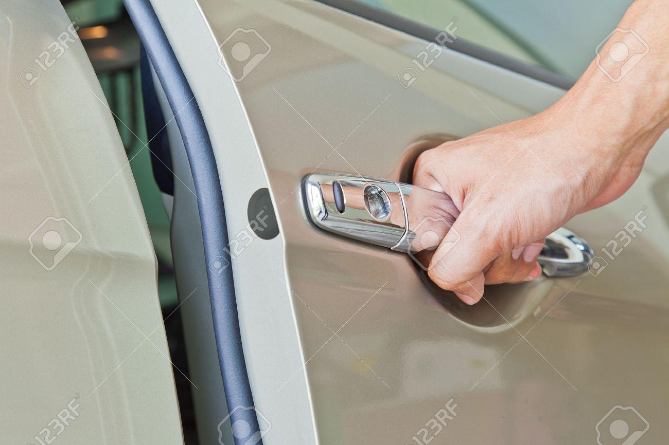 Hand open door car Stock Photo - 10286606