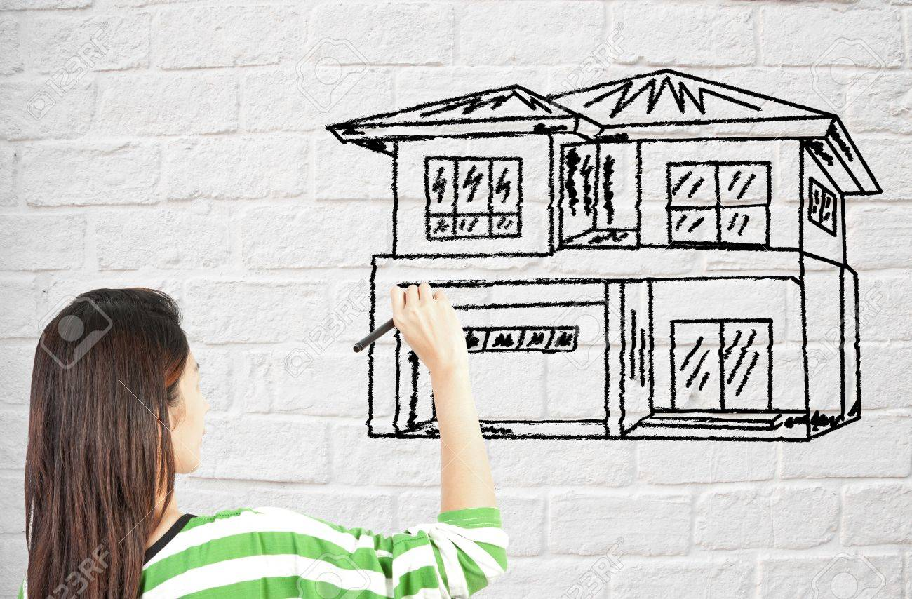 Woman Draw House On Brick Wall Stock Photo Picture And Royalty Free Image Image 14171761