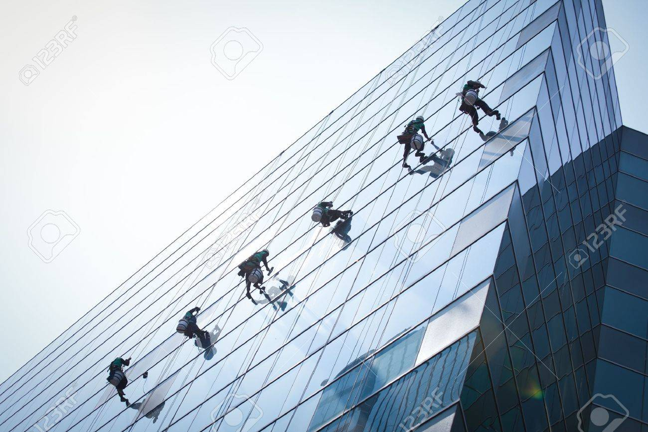 group of workers cleaning windows service on high rise building Stock Photo - 18490049