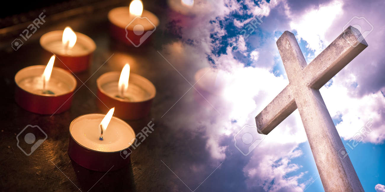 Christian cross against a dramatic cloudy sky - concept image with red votive candle. - 166002941
