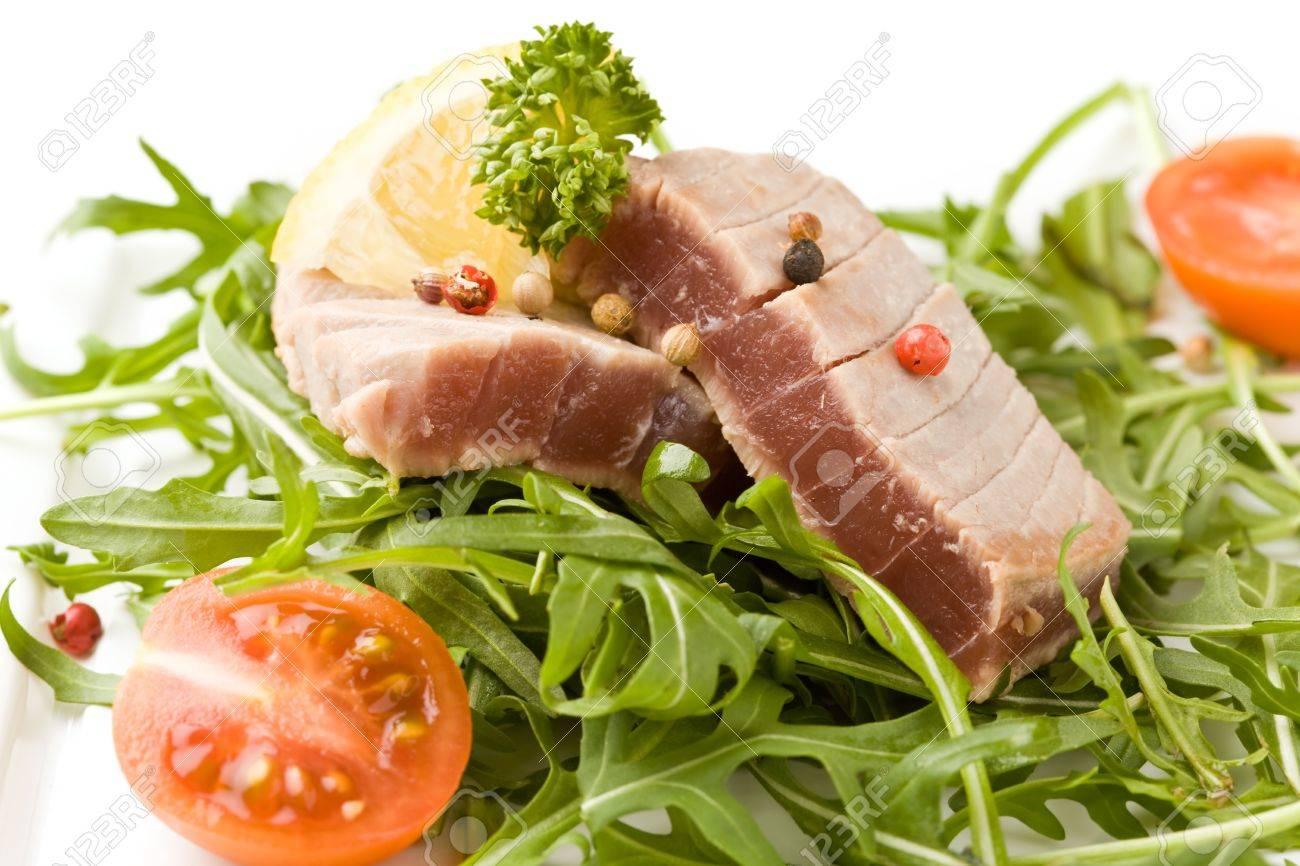 photo of sliced Tuna Steak with arugula salad  on white isolated background Stock Photo - 9194442