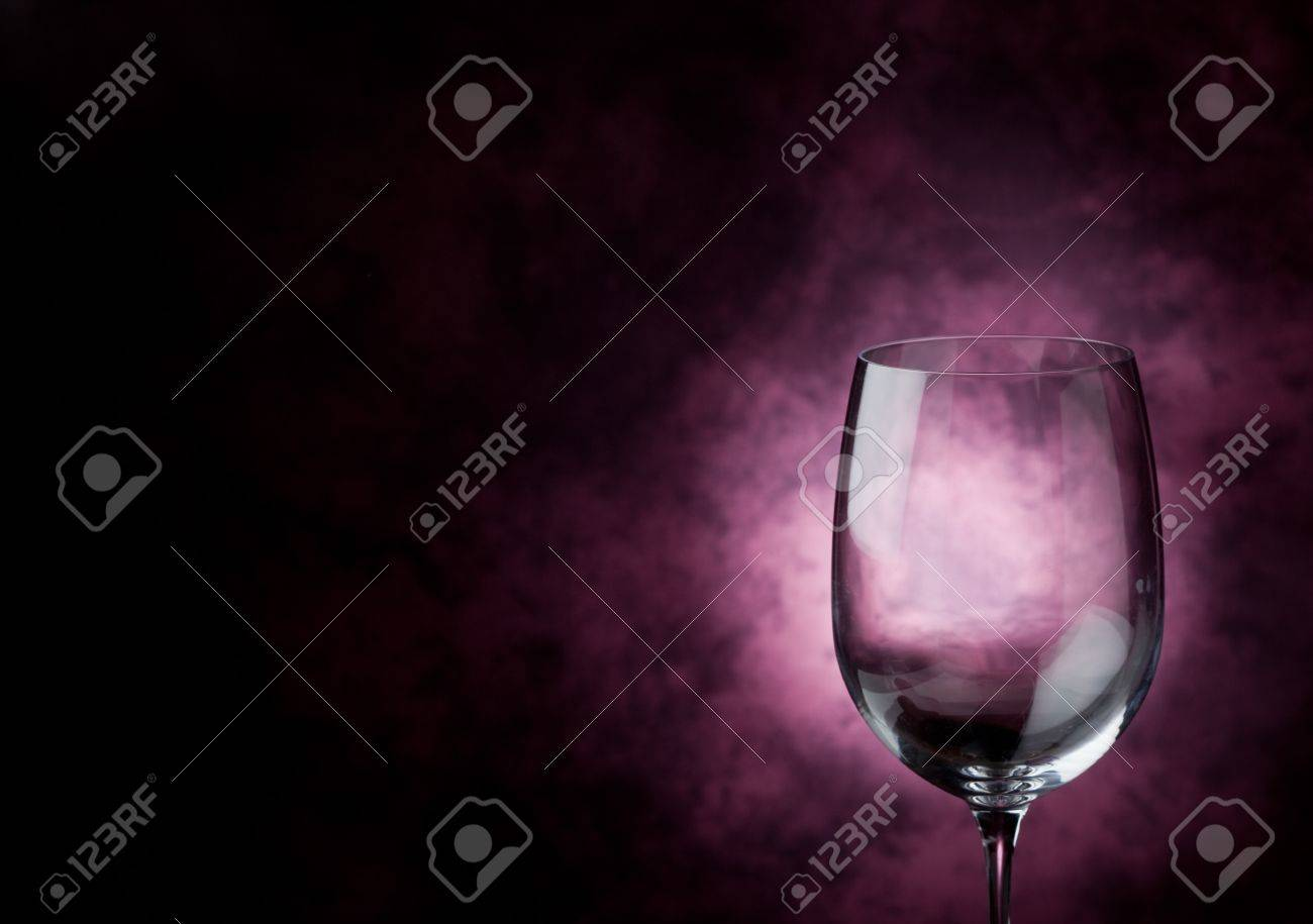 Photo of Red Wine inside a wine glass with abstract background Stock Photo - 9316780