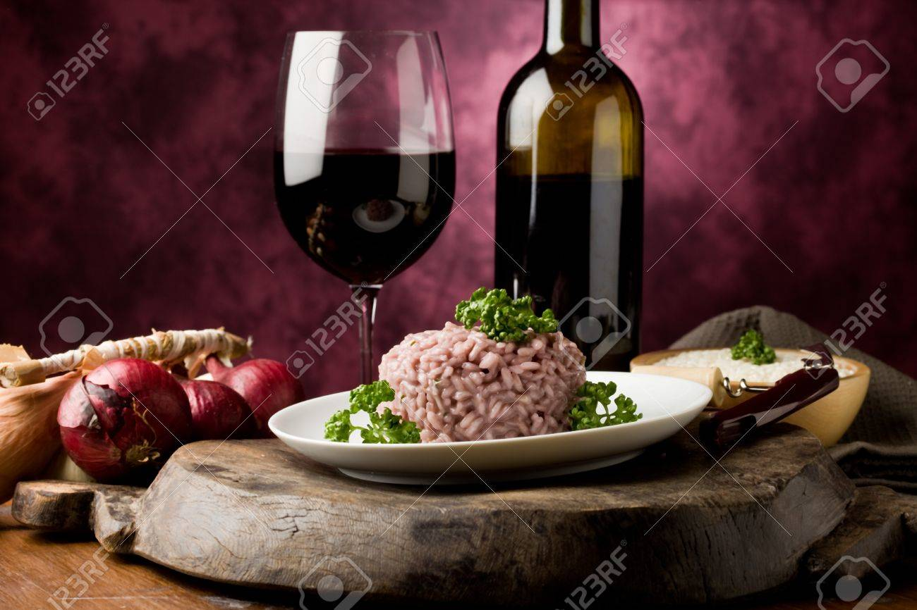 photo of delicious risotto with red wine on wooden table Stock Photo - 9456435