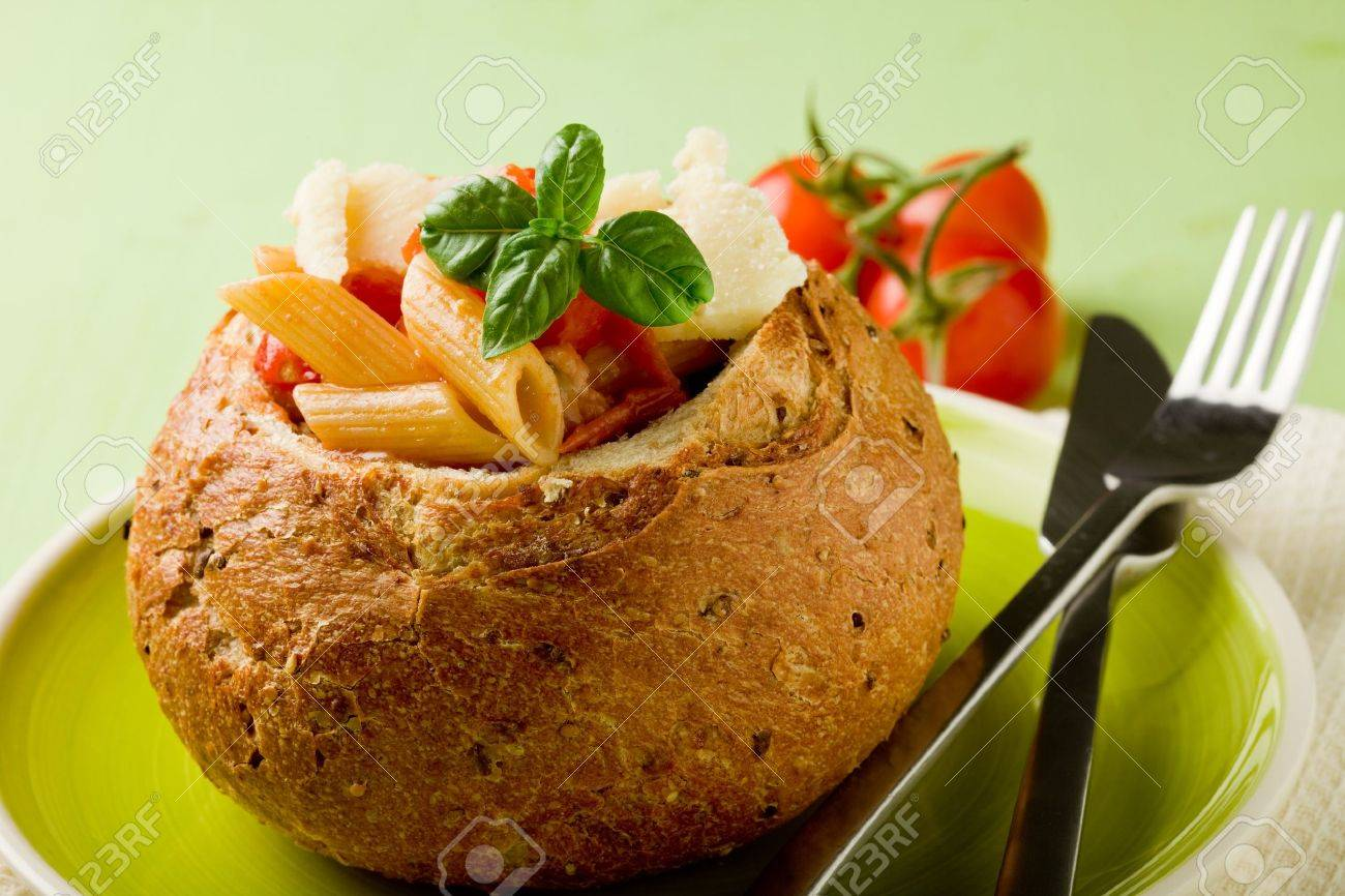delicious multi grain bread stuffed with pasta on green plate Stock Photo - 9587316