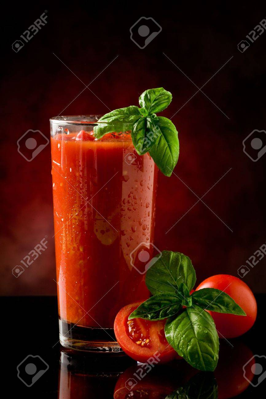 delicious tomato bloody mary cocktail on reflecting glass table with spot light Stock Photo - 9703632