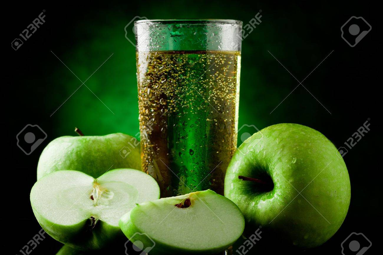 Fresh sparkling green apple juice on green spot lighted background Stock Photo - 9703712