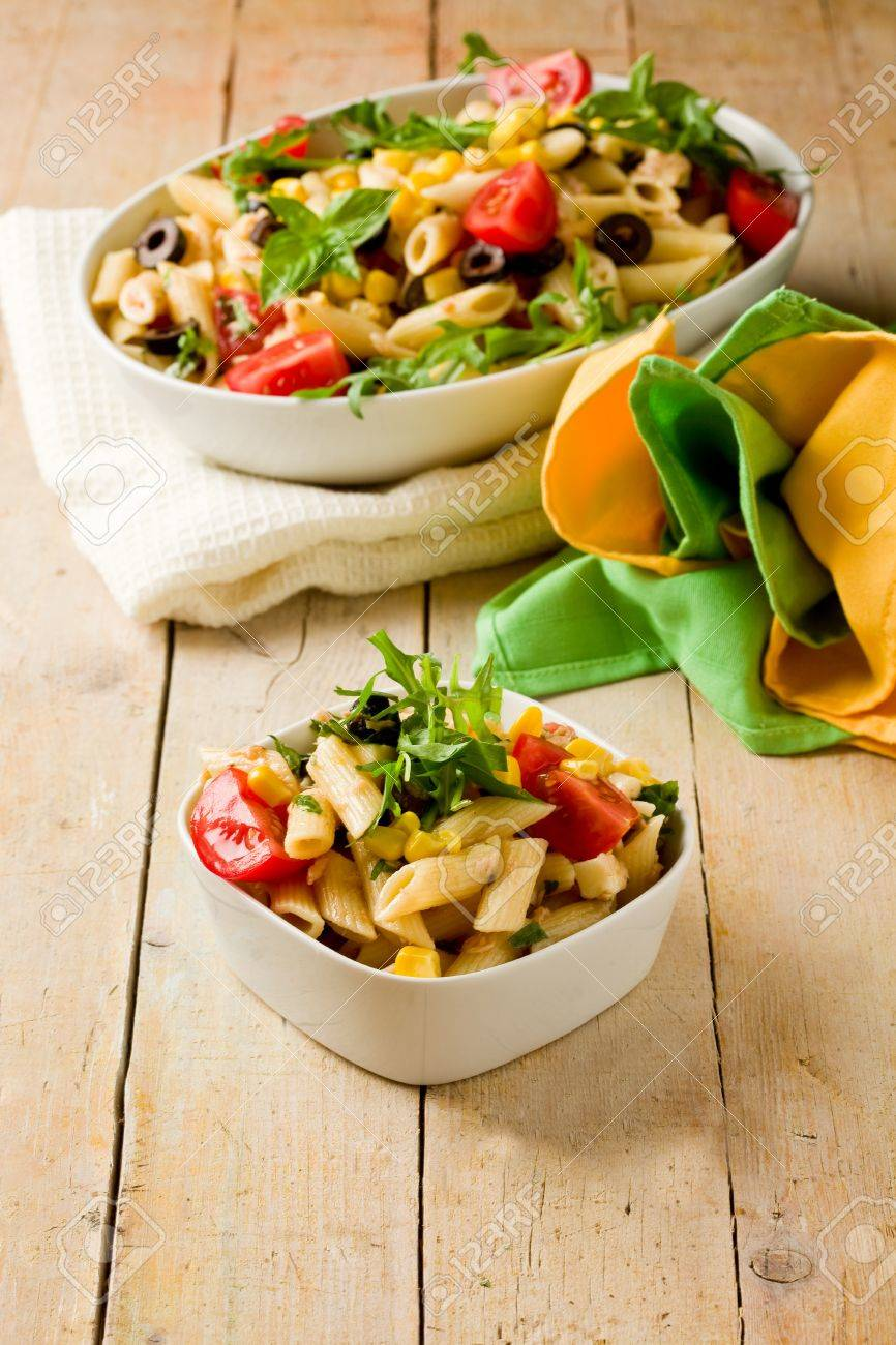 photo of delicious tasty pasta salad on wooden table with fresh vegetables Stock Photo - 10099798