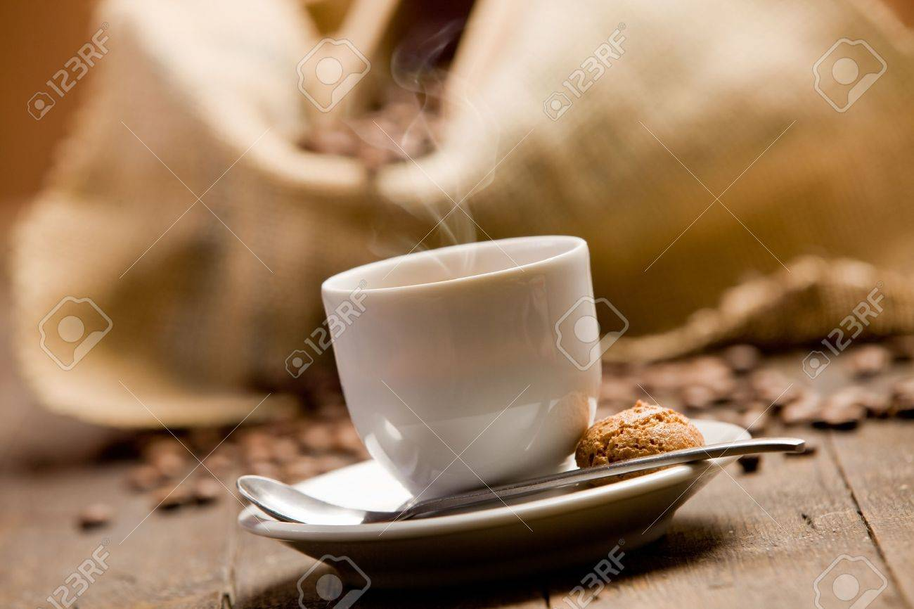 Photo of delicious hot espresso coffee on wooden table Stock Photo - 11969030