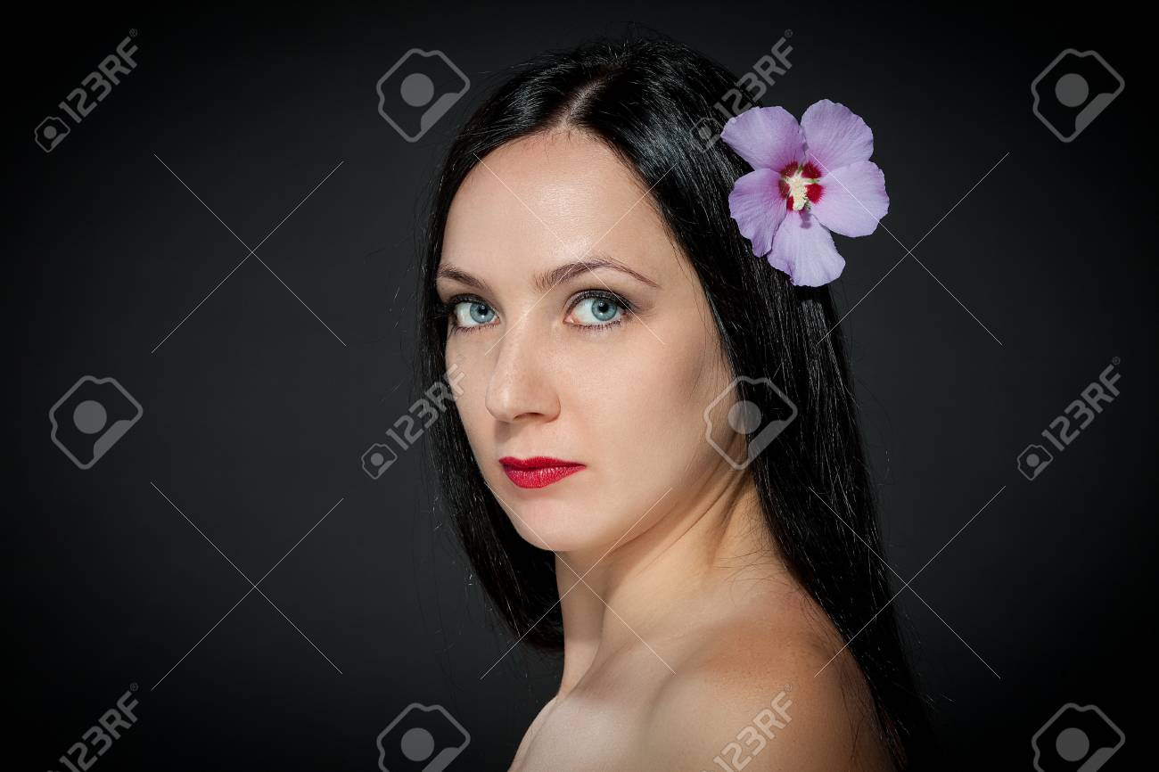beautiful female with flower in her hairs Stock Photo - 16128772