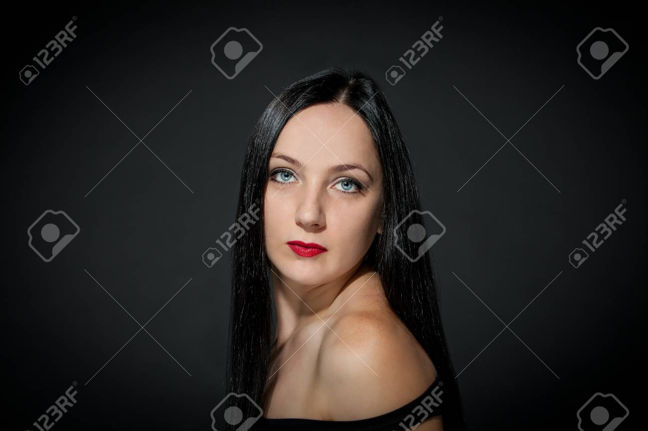 photo of a beautiful girl with black hairs on grey rural backgrond Stock Photo - 16334710