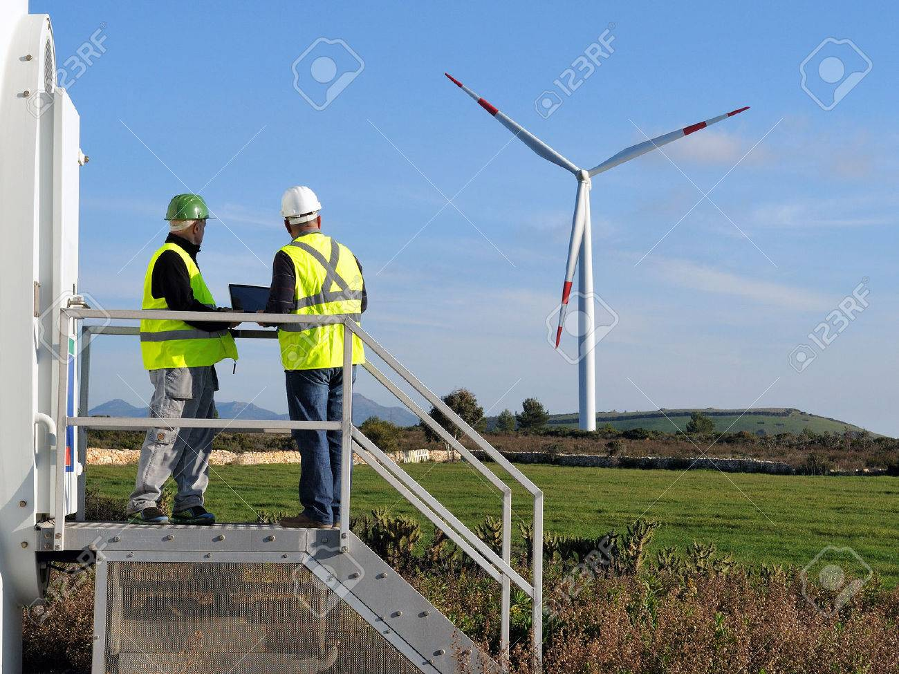 Technicians engaged in the detecting of a wind turbine installation for the production of energy - 52184838