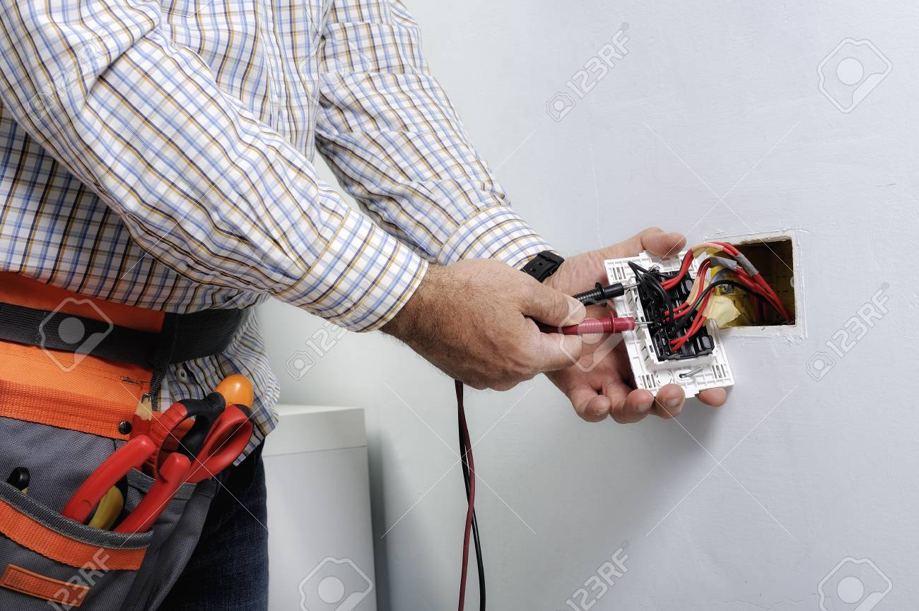 Electrician At Work On Switches And Sockets Of A Residential.. Stock ...