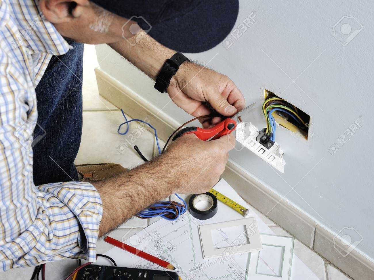 Electrician Stripping The Cable To Connect Switches And Sockets Residential Electric Wiring Of A Electrical Installation Stock Photo