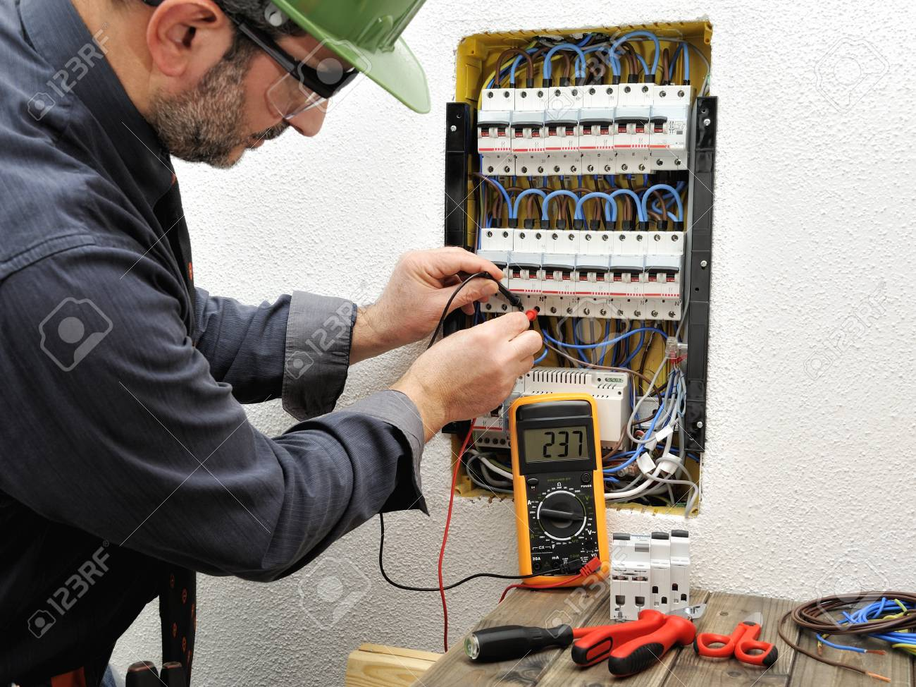 Technical Electrician Measures The Voltage Of A Circuit Breaker ...