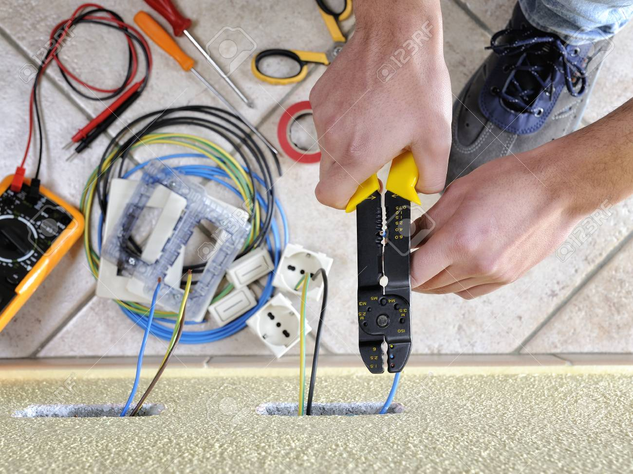 Electrician Technician At Work Uses The Wire Stripper In A ...