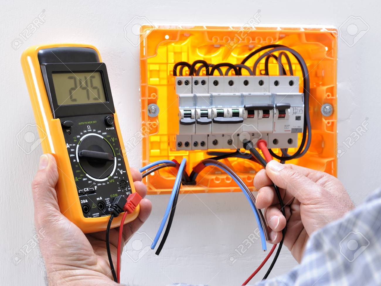 Circuit Breaker House Panel Electrician Technician Working On A Residential Electrical Measures The Voltage Terminals Of