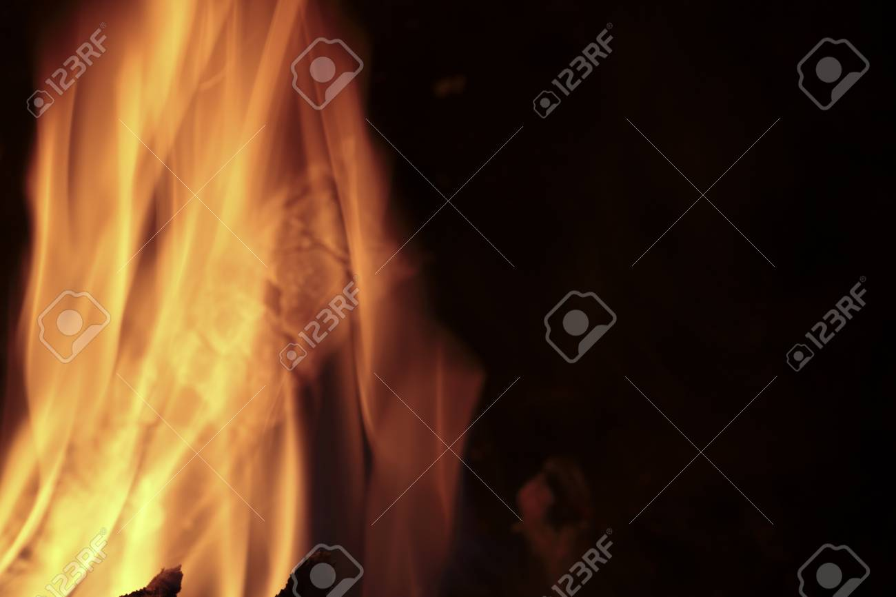 Flames of fire in a fireplace  Shooting horizontal with tones