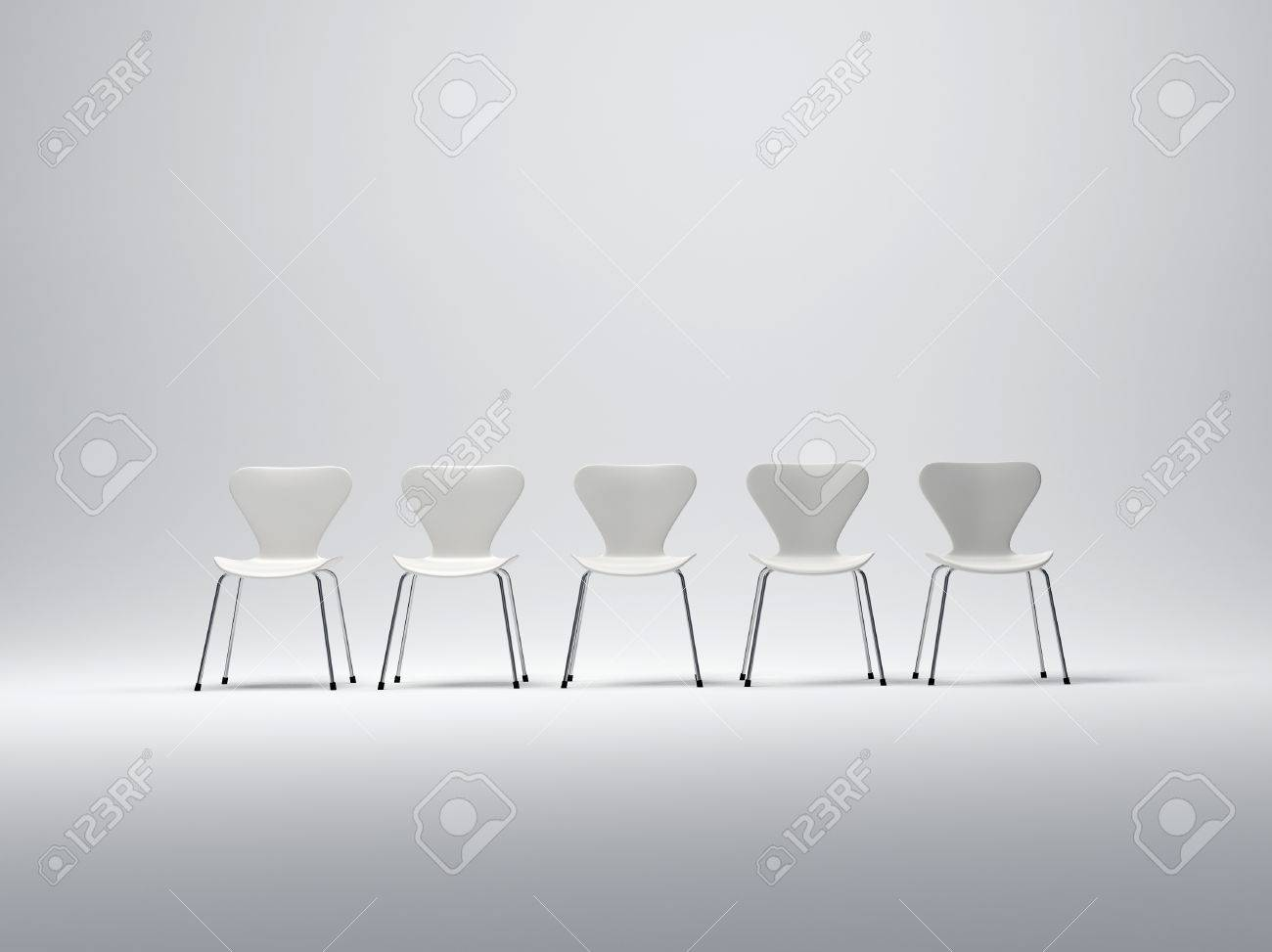 plastic metal chairs. Row Of Five White Plastic And Metal Chairs In A Neutral Background Stock Photo - 1584897