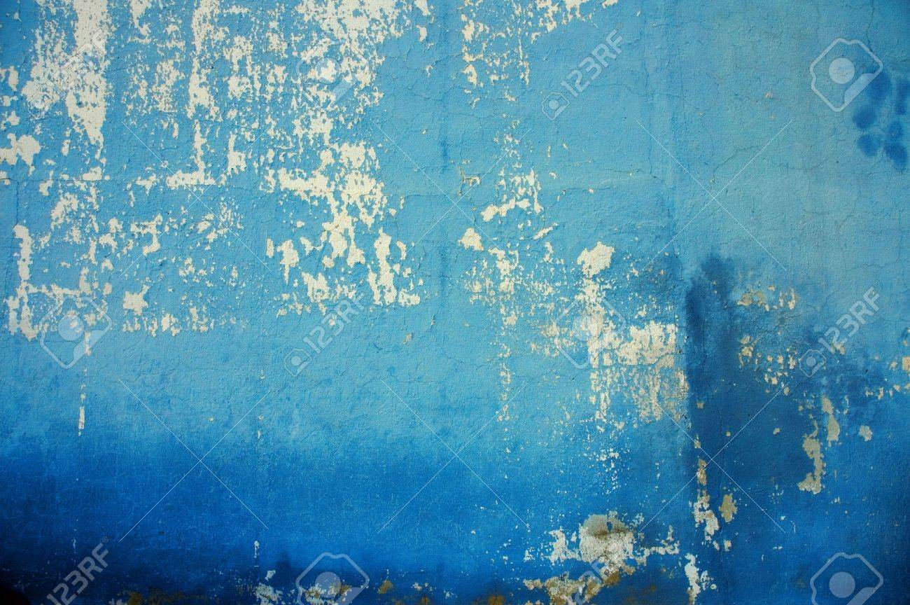 old wall with cracked blue paint stock photo picture and royalty
