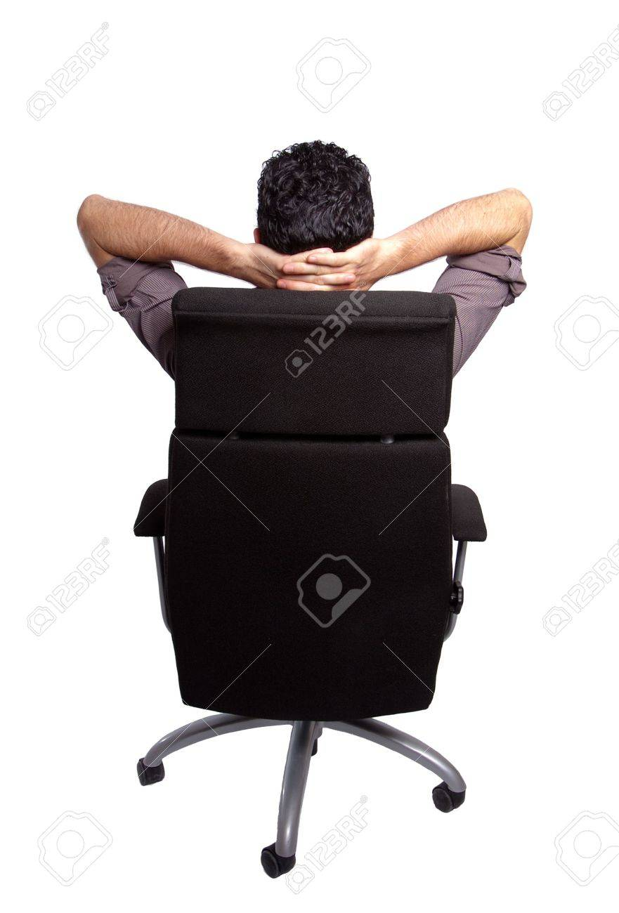 Back View Of A Man Relaxing On An Office Chair Stock Photo Picture And Royalty Free Image Image 5653196