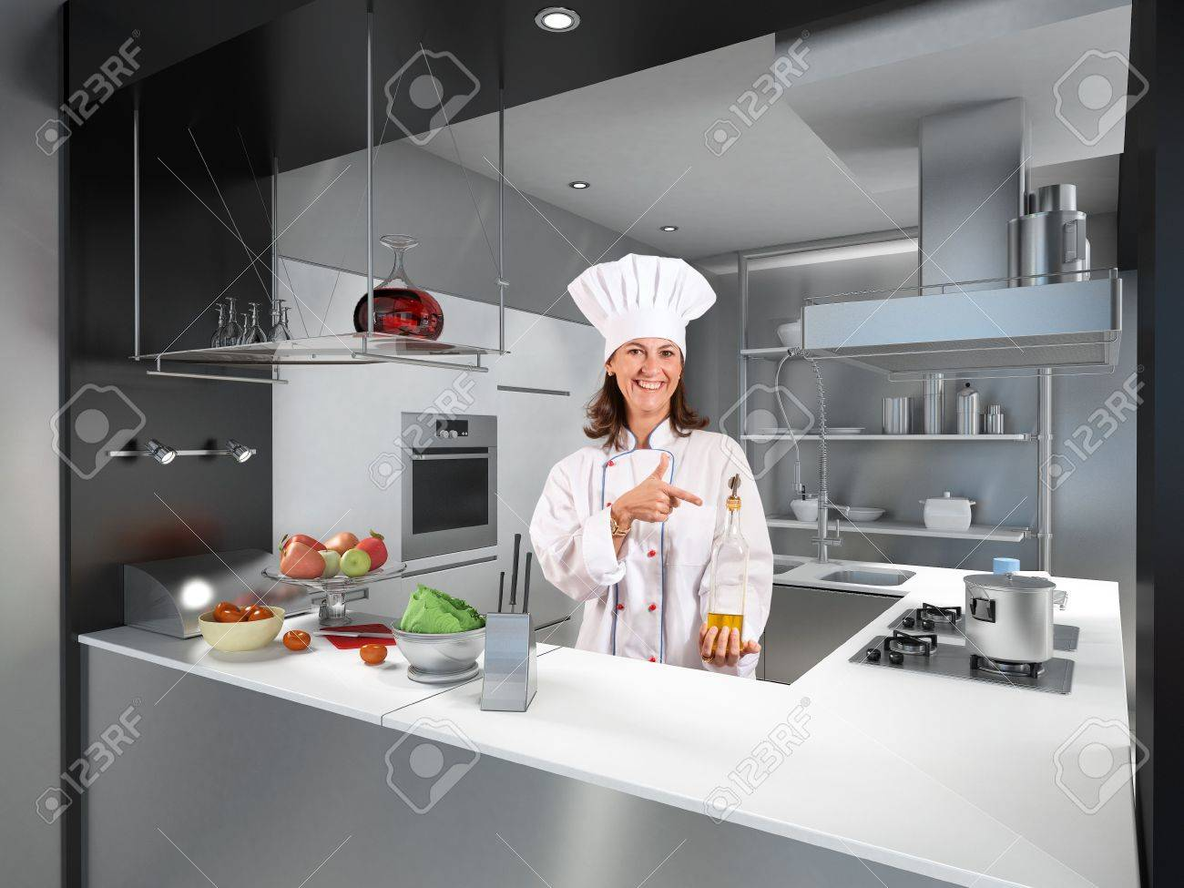 Restaurant Kitchen Counter smiling female chef behind a modern kitchen counter pointing