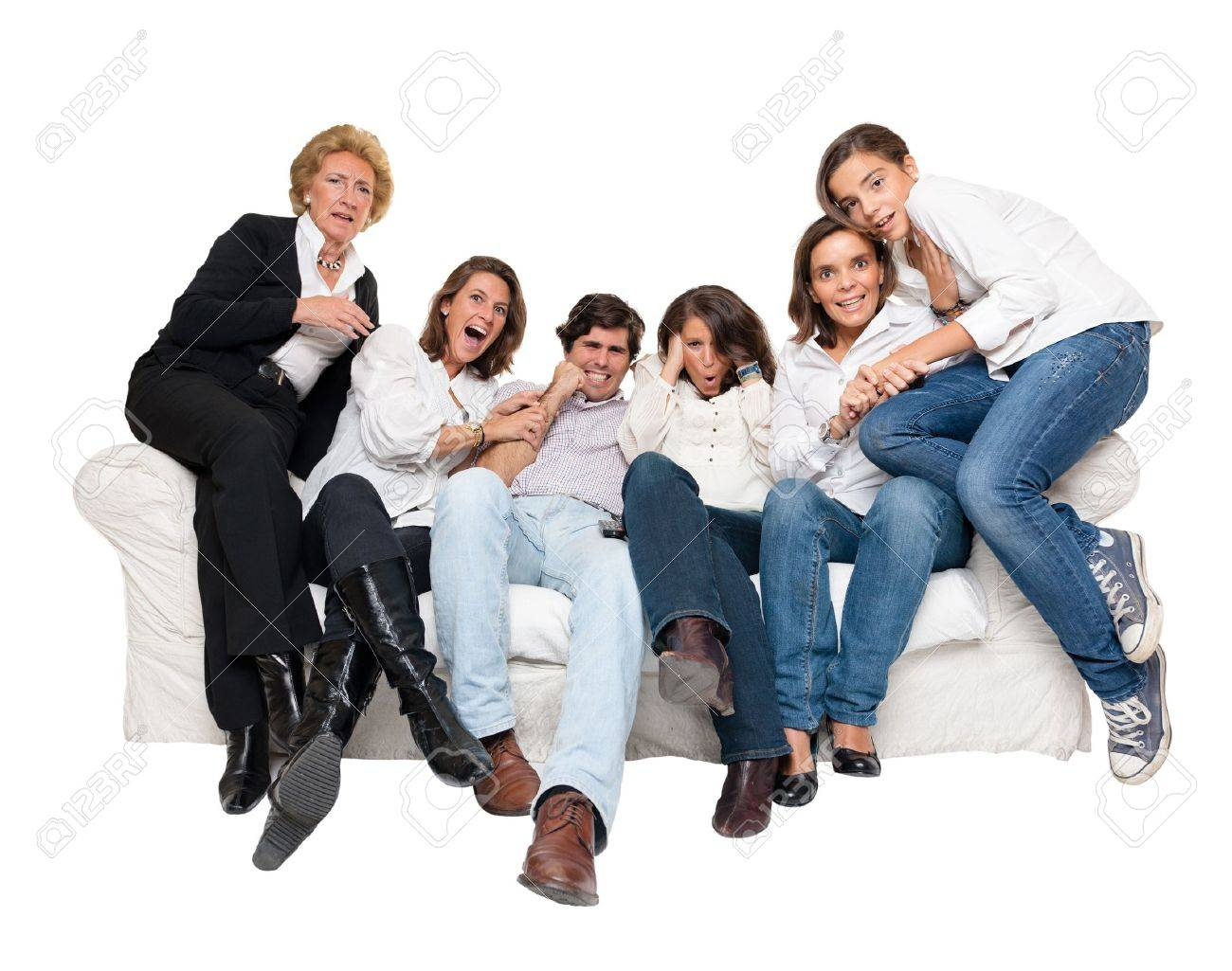 A group of family members sitting at home watching nervously TV Stock Photo - 9948115